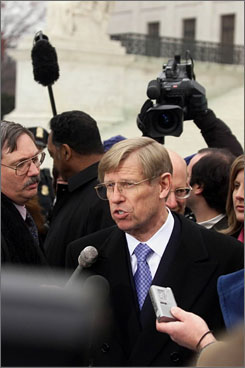Former U.S. solicitor general Theodore Olson, center, talks to reporters outside the U.S. Supreme Court in Washington. Olson has friends among the justices, but he says friendship and business don't mix.