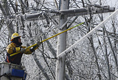 J.C. Zwick works on restoring power lines in Jaffrey, N.H., Sunday. President Bush declared a state of emergency for New Hampshire and nine of Massachusetts? 14 counties, directing FEMA to provide assistance.