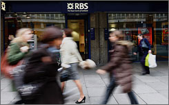 Pedestrians walk past a branch of the Royal Bank of Scotland in London in November.