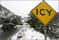 A California Highway Patrol vehicle drives up a road in the Angeles Crest area of La Canada, Calif.