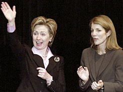 Caroline Kennedy, right, and Hillary Clinton wave to the crowd following a campaign speech for Clinton's Senate race on Oct. 17, 2000. Kennedy, from a famous political family, has decided to pursue the Senate seat of Clinton, who has been nominated Secretary of State.