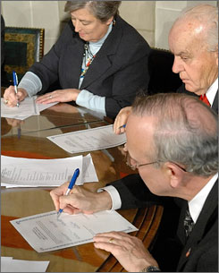 William Forsee, front, representing Nebraska's Second Congressional District, signs one of five certificates of vote during the Electoral College meeting Monday.   In all 50 states and the District of Columbia, the 538 electors performed a constitutional process to legally elect Democrat Barack Obama the 44th president.