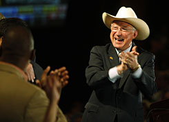 U.S. Sen. Ken Salazar, D-Colo., right, celebrates with campaign workers after his speech during the Democrats' gala in Denver on Nov. 4.