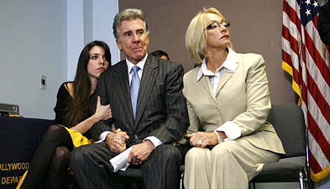 John Walsh and his wife, Reve, right, along their daughter, Meghan listen as the Hollywood, Fla., Police Department announce on Tuesday the conclusion of the investigation in to the death of their son, Adam, who was abducted and killed in 1981.