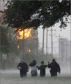 A police officer helps residents evacuate during Huricane Ike on Sept. 12 in Galveston, Texas.