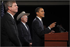 President-elect Barack Obama introduces former Iowa governor Tom Vilsack, at left, and Sen. Ken Salazar on Wednesday.