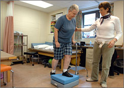 Physical therapist Wendy Carboni, right, works with Sister Mary Nagle during a physical therapy session at Bethany Heath Care Center after Nagle's knee-replacement surgery.