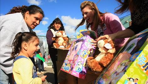 A child chooses a toy at a Miracle in South Central event Dec. 13 to help the disadvantaged families in L.A.