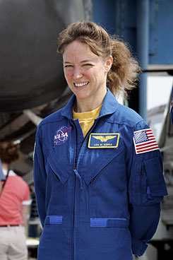 Mission Specialist Lisa Nowak is pictured outside the Space Shuttle Discovery in July 2006 after its arrival at the Kennedy Space Center in Cape Canaveral, at the completion of a mission.