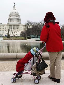 Celerina Tagulao pushes her three-year-old granddaughter in a stroller near the Capitol. Strollers are just one of the items prohibited on Capitol grounds during the inauguration.