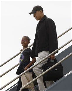 President-elect Barack Obama lands in Honolulu for a 10-day holiday vacation with his daughter Sasha Saturday.