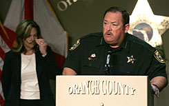 A tearful Sheriff Kevin Beary responds to media questions at a press conference in Orlando on Friday on the personal toll this case has caused him after Medical Examiner Dr. Jan Garavaglia, left, announced that she has ruled the death or Caylee Anthony a homicide.