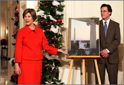 Laura Bush introduces Christmas card artist T. Allen Lawson and his work during a media preview of the 2008 holiday decorations in early December.