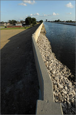 Communities nationwide have repaired fewer than half of the 122 levees identified by the government almost two years ago as too poorly maintained to be reliable in major floods, according to Army Corps of Engineers data. Seen here is a repaired levee along the 17th Avenue Canal in New Orelans.
