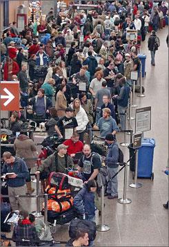 Hundreds of passengers wait Sunday at the Seattle-Tacoma International Airport.