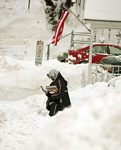 U.S. Postal Service mail carrier Adriana Hansen navigates through snow banks in Bath, Maine, on Monday.
