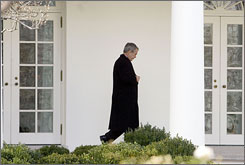 President Bush leaves the Oval Office of the White House before departing for Camp David on Tuesday.  Bush has now pardoned or commuted the sentence of 199 people during his eight-year term.