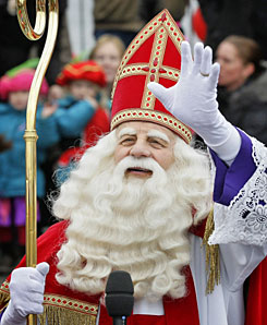 St. Nicholas waves to children as he arrives by boat in Almere, The Netherlands, on November 15.