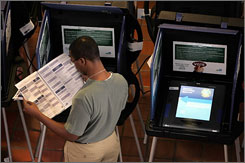 A resident of Miami-Dade casts his vote on electronic voting machines in 2004. A new study shows election ballots could be safely distributed electronically to Americans overseas, but getting their votes back securely could present problems.