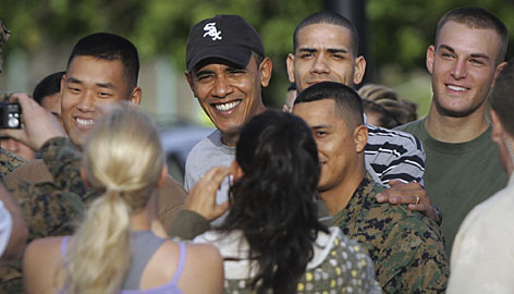 President-elect Barack Obama takes a group photo with Marines after his workout at the Kaneohe Bay Marine Corps Base in Kailua, Hawaii, on Monday.