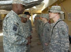 Lt. Gen. Lloyd J. Austin III, commander, Multi-National Corps  Iraq, presents coins of excellence to 3rd Squadron, 4th Cavalry Regiment, 3rd Brigade Combat Team, 25th Infantry Division Soldiers deployed to Forward Operating Base Paliwoda Dec. 25 in Balad, Iraq.