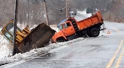 This dump truck and front end loader slipped off an icy State Road 23 just South of Ice Trail Dec. 26 following an ice storm, in South Bend, Ind. after a semi truck lost control in the just North of this accident.