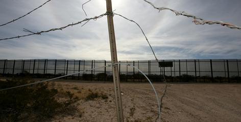 The five-strand barbed wire fence in the foreground used to be all that separated the United States from Mexico, in the area of Sunland Park, N.M, But new fencing, seen in the background, was recently completed.