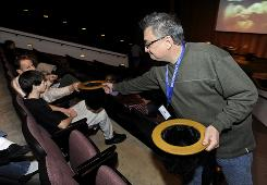 Volunteer Jim Mueller collects donations during service at Waterfront Community Church in Schaumburg, Ill., Sunday, Dec. 14. Since it started in October, Waterfront has raised more than $11,500 for charity.