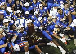 University of Florida players celebrate their win against the University of Alabama at their NCAA Southeastern Conference title college football game in Atlanta on Dec. 6. Gators football players on average scored 346 points lower on college entrance exams than the school's overall student body, according to a report.
