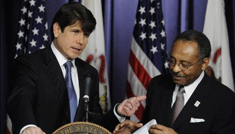 Governor Rod Blagojevich with Roland Burris(right)