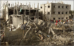 Palestinians look at destroyed houses after an Israeli air strike in Rafah in the southern Gaza Strip on Tuesday.