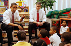 U.S. President-elect Barack Obama, left, and Secretary of Education nominee Arne Duncan talk to students at the Dodge Renaissance Academy in Chicago, Dec. 16.