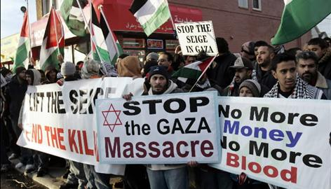 Arab-Americans line a street in Dearborn, Michigan to protest against Israeli military strikes on the Gaza Strip.