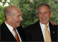 Israeli Prime Minister Ehud Olmert, left, walks with President George W. Bush prior to their meeting at the White House in Washington in June.