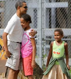 President-elect Barack Obama embraces his older daughter Malia as younger daughter Sasha looks on before entering the Honolulu Zoo Dec. 30 in Honolulu, Hawaii.