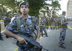 Sri Lankan soldiers secure the site of an explosion outside an Air Force camp in Colombo, Sri Lanka.