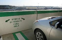 "This parking spot at Boston's Logan International Airport is reserved for ""green"" machines."