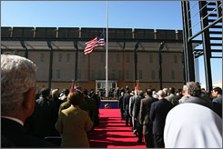 The U.S. flag is raised Monday during a ceremony marking the opening of the new U.S. Embassy in Baghdad, Iraq.