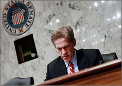 The lawyer for U.S. Sen. Norm Coleman, R-Minn., seen here at a Senate Homeland Security Committee meeting on Dec. 11, has vowed to challenge any decision a state canvassing board might render over whether Democrat Al Franken has won the right race.
