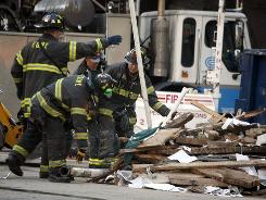 This March 17, 2008 photo shows the scene of a crane collapse in midtown Manhattan that killed seven people and injured dozens. William Rapetti, the contrator responsible for the crane, and his firm have been indicted on homicide charges, Manhattan District Attorney Robert Morgenthau said Monday