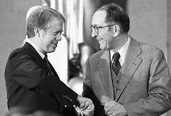 In this Jan. 26, 1977 file photo, President Jimmy Carter congratulates Griffin Bell after Bell took the oath of office as Attorney General during a ceremony at the Justice Department in Washington. Bell died Monday in an Atlanta hospital, Bell's law firm said. He was 90.