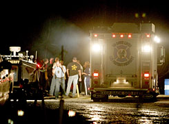 Emergency personnel at a boat launch in Gibson, La., coordinate recovery efforts for the bodies of eight people killed Sunday when a helicopter transporting oilfield workers went down in western Terrebonne Parish, about 100 miles southwest of New Orleans.