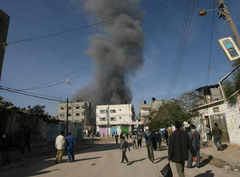 Smoke billows from an Israeli air strike in the Gaza Strip on Monday.