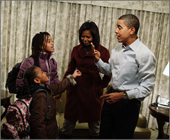 President-elect Barack Obama and his wife, Michelle Obama, help their daughters, Sasha, 7, left, and Malia, 10, get ready for their first day of school Monday from their temporary living quarters at the Hay Adams Hotel in Washington.