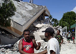 Residents inspect a collapsed hotel after an earthquake struck in Manokwari, Papua province, Indonesia, Sunday. A series of powerful earthquakes injured dozens in remote eastern Indonesia on Sunday, cutting power lines and badly damaging buildings.