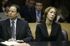 Christine Beatty sits with her attorney before her sentencing in Detroit on Tuesday. Nearly a year after headlines revealed a City Hall sex scandal, the former top aide to ex-Mayor Kwame Kilpatrick was sent to jail to serve the same punishment as her boss: 120 days with time shaved for good behavior.
