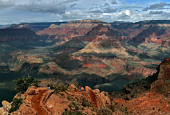 With the North Rim in the background, tourists hike along the South Rim of the Grand Canyon in this February 2005 photo in Arizona.