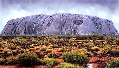 Ayers Rock (Uluru) takes on an unusual color as waterfalls cascade down its walls in central Australia in February 2000. The rock, which is usually a reddish color, is shown after heavy rains and is seldom seen like this. Starting this month, a global poll will allow people worldwide to vote and select the seven natural wonders of the world.