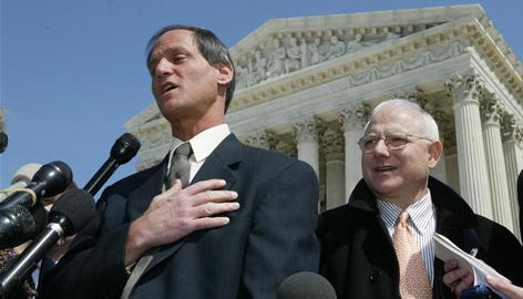 "Michael Newdow, left, a California atheist who challenged the Pledge of Allegiance on behalf of his daughter, speaks outside the Supreme Court in Washington in 2004. Newdow told the court that the words ""under God"" are unconstitutional and offensive to people who don't believe in God. Newdow also wants God out of the presidential oath and wants the inaugural invocation and benediction eliminated."