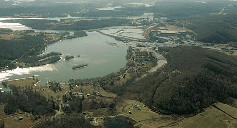 The broken containment pond which sent a billion gallons of toxic coal ash sludge into the Emory River and surrounding lands is shown at right center adjacent to the Tennessee Valley Authority's Kingston Fossil Plant Dec. 29, 2008, in Harriman, Tenn.